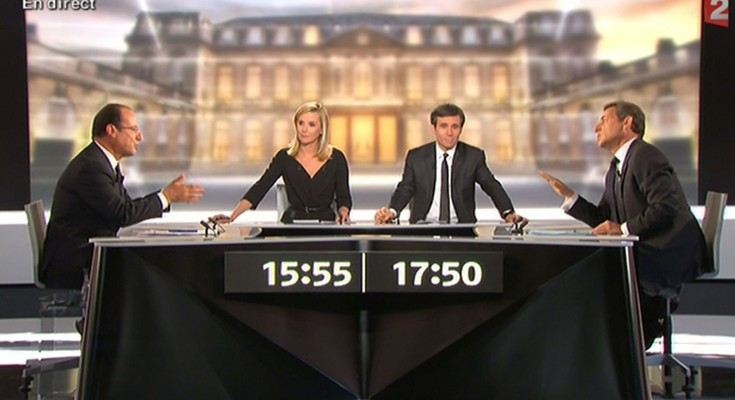 An image grab taken from French TV France 2 shows the candidates for the 2012 French presidential election, France's Socialist Party (PS)'s Francois Hollande (L) and France's incumbent president and Union for a Popular Movement (UMP)'s  Nicolas Sarkozy (R) posing with journalists David Pujadas (C-R) and Laurence Ferrari (C-L) during their national TV debate between the two rounds of the presidential election on May 2, 2012 at the TV broadcast studio in La Plaine Saint-Denis, outside Paris.   AFP PHOTO / FRANCE 2 / AFP / FRANCE 2 / -