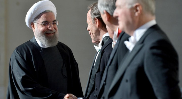 Iranian President Hassan Rouhani (L) greets people at the Vatican on January 26, 2016, upon his arrival to meet the Pope.